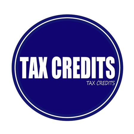 tax bracket: TAX CREDITS white stamp text on blue Stock Photo