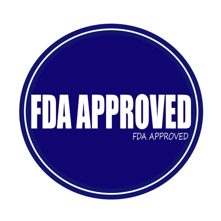fda: FDA APPROVED white stamp text on blue Stock Photo