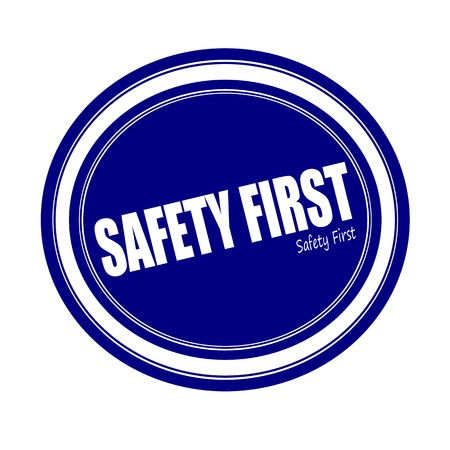 safety first: SAFETY FIRST white stamp text on blue