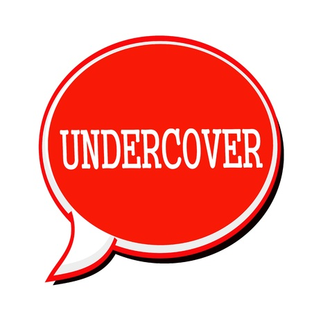 undercover: UNDERCOVER white stamp text on red Speech Bubble