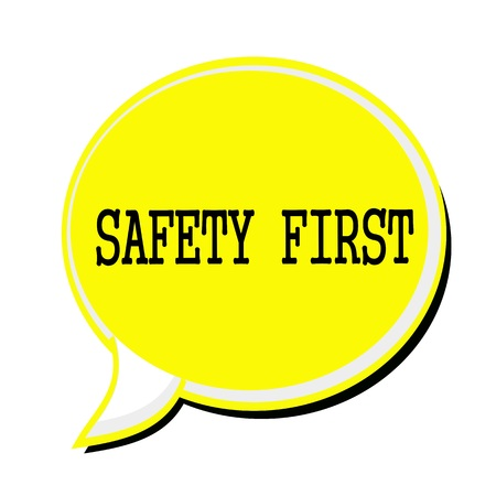 safety first: SAFETY FIRST black stamp text on yellow Speech Bubble