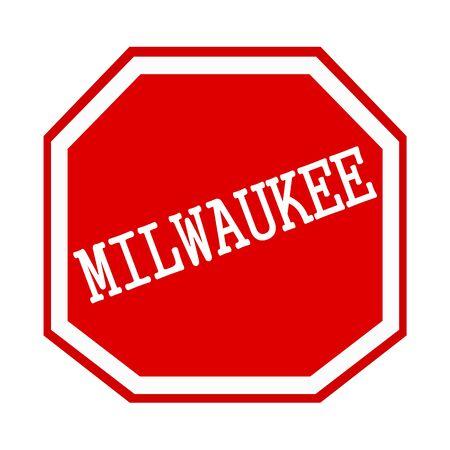 Milwaukee: MILWAUKEE white stamp text on red octagon
