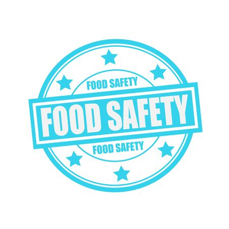 Food safety white stamp text on circle on blue background and star Reklamní fotografie