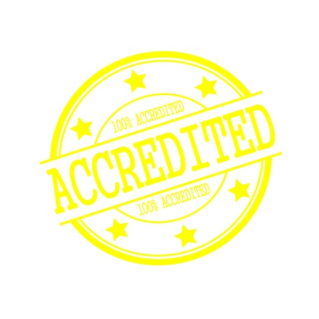 accredited: accredited yellow stamp text on yellow circle on a white background and star Stock Photo