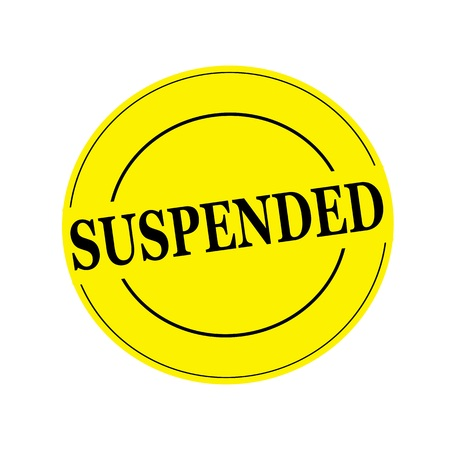 suspended: suspended Black stamp text on circle on yellow background