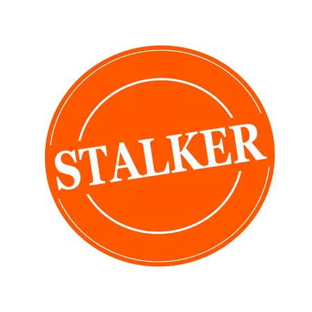 stalker: STALKER white stamp text on circle on orage background Stock Photo