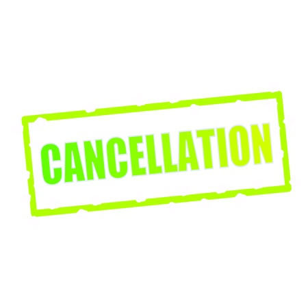 chipped: CANCELLATION wording on chipped green rectangular signs Stock Photo