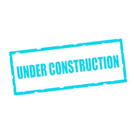 chipped: under construction wording on chipped Blue rectangular signs Stock Photo