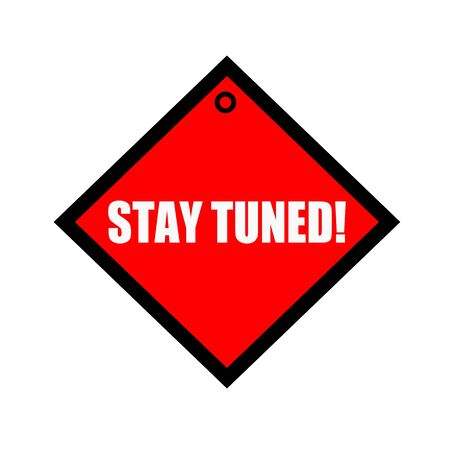 tuned: Stay tuned black wording on quadrate red background Stock Photo