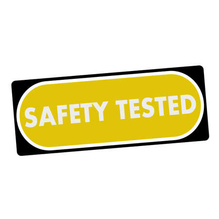 tested: safety tested white wording on yellow background  black frame Stock Photo