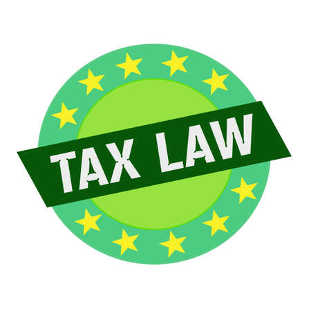tax law: TAX LAW white wording on green Rectangle and Circle green stars Stock Photo