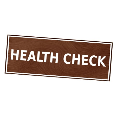 health check: health check white wording on Brown wood background