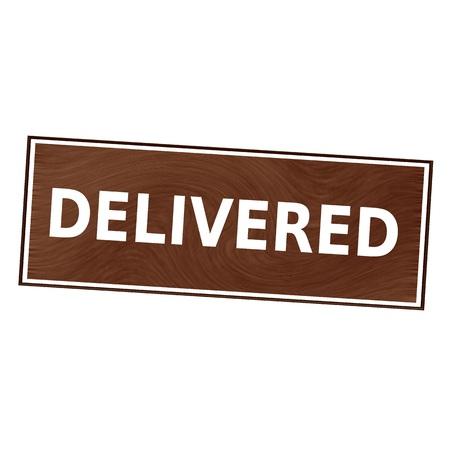 delivered: delivered white wording on Brown wood background