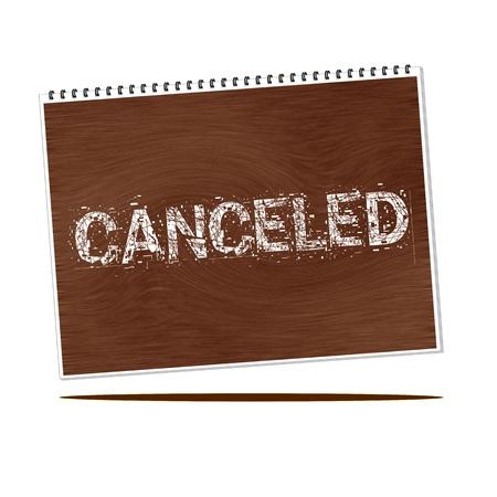 canceled: canceled white wording on Notebook wood background Stock Photo