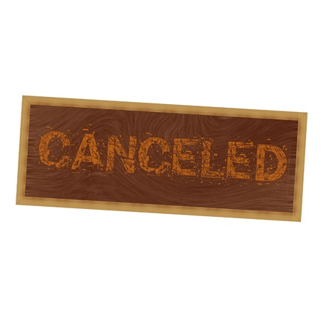 canceled: canceled orange wording on picture frame wood brown background Stock Photo