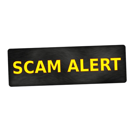 scam: SCAM alert yellow wording on black wood background