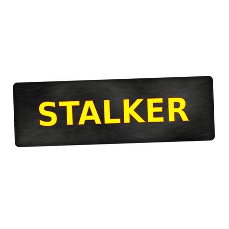 stalker: STALKER yellow wording on black wood background Stock Photo