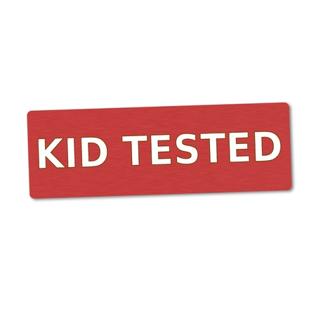 tested: kid tested white wording on red wood background