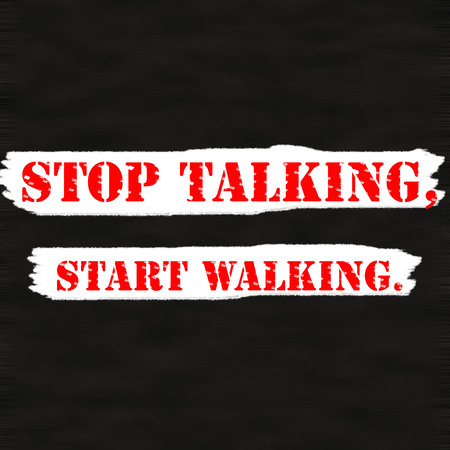 STOP TALKING,START WALKING.Creative Inspiring Motivation Quote Concept Red Word On Black wood Background.