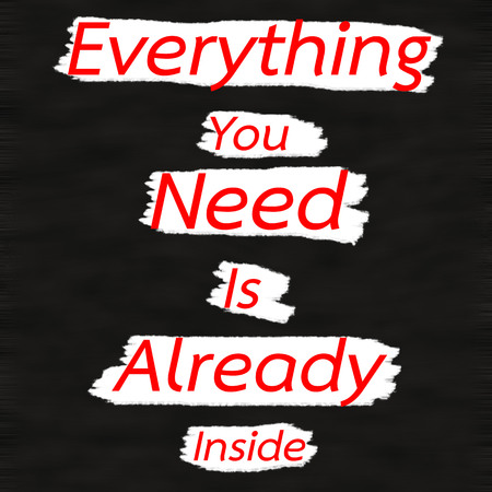 Everything You Need Is Already Inside.Creative Inspiring Motivation Quote Concept Red Word On Black wood Background. 版權商用圖片