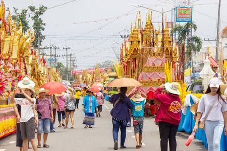 Yasothon, Thailand - May 11 2019: Traditional thai dance group at the parade at Thai Rockets festival (Boon Bang Fai) It is held every year around May at Yasothon in Esan, north east of Thailand
