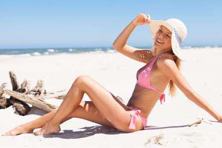 beautiful nude women: Beautiful woman sunbathing on the beach.