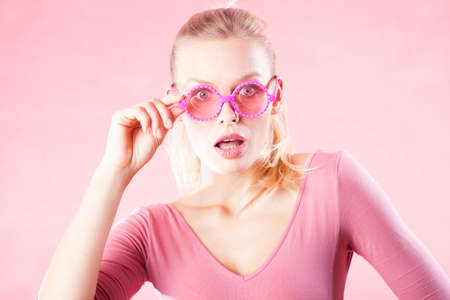 not open: Shocked woman in pink glasses! Wow! Special prices, only today. Stock Photo