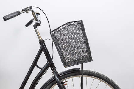 Old vintage black lady bicycle with a basket. Stockfoto