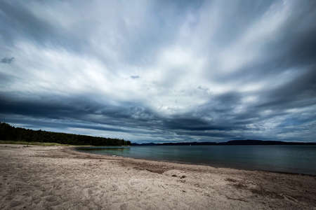 Dramatic sky over beautiful sandy beach and archipelago in Gulf of Bothnia. Storsand, High Coast in northern Sweden.