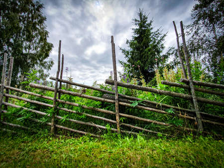 Old traditional Swedish wooden fence. (called gärdsgård in Swedish)
