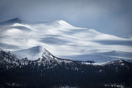 Winter landscape with dramatic snowy mountains. Stock fotó