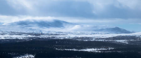Winter landscape with foggy snowy mountains. Panorama Stock fotó