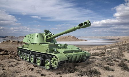 anti war: Soviet 152-mm self-propelled howitzer divisional against the desert landscape  Developed in the Ural factory of Transport Engineering