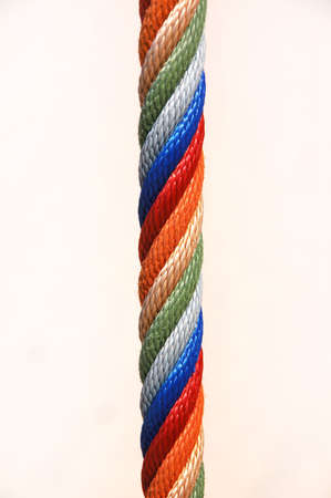 A multi-colored rope against white background Stock Photo