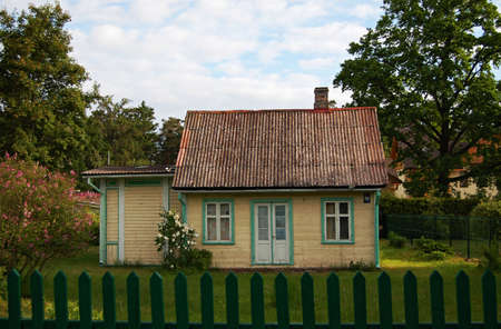 The rural house behind a fence in the afternoon Stock Photo - 6275807
