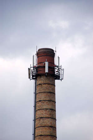 factory chimney against the grey sky