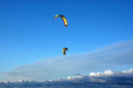kiteserfers kites against the blue sky Stock Photo