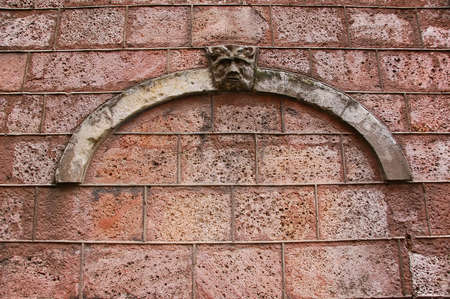 Old rough wall with a decorative element photo