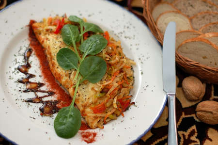 omelette garnished by vegetables and greens