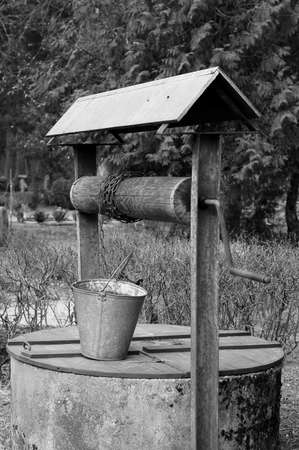 Old well for water on a cemetery  B W