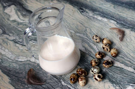 still life with milk and quail eggs on a marble surface Stock Photo