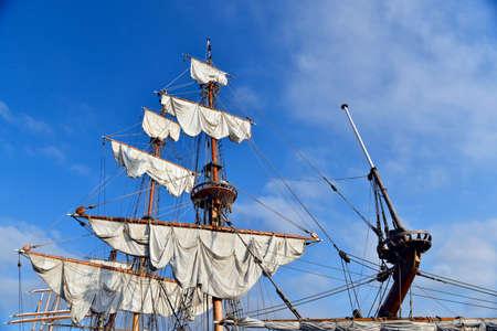 yacht mast with sails against the sky