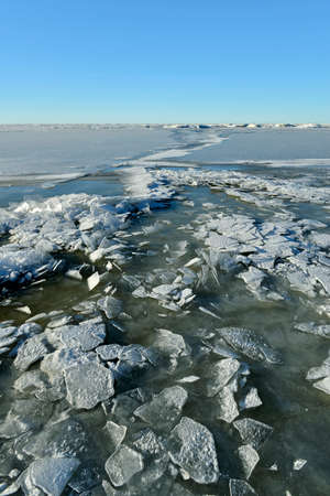 the frozen winter sea with ice blocks