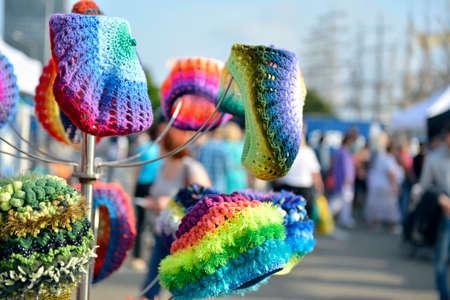 bright, multi-colored hats on sale in the market Stock Photo
