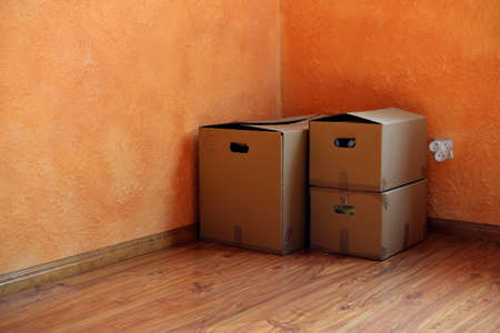boxes with things in the empty room
