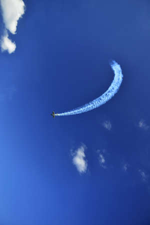 the flying airplane against the blue sky