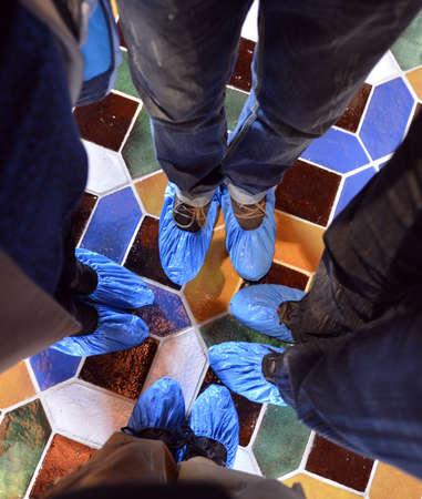 peoples feet wearing booties Stock Photo