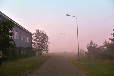 Early foggy morning in a village street