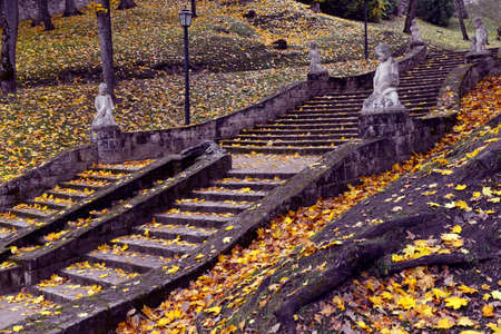Staircase with stone sculptures at the autumn park in Cesis Stock Photo