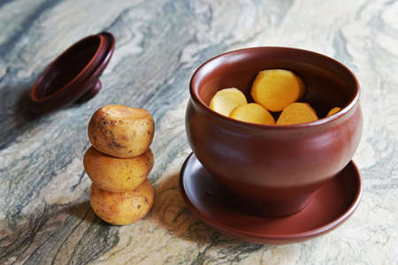 Preparation of turnip baked in a pot Stock Photo